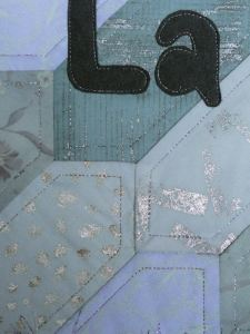 detail showing foil and paint